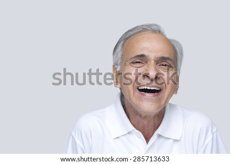 Senior man laughing over white background - stock photo