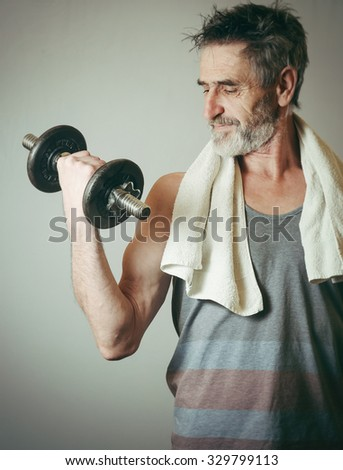 Senior man lifting weights  - stock photo