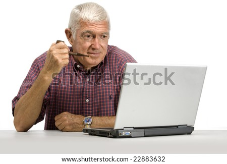 Senior man looking at a laptop on a white background - stock photo