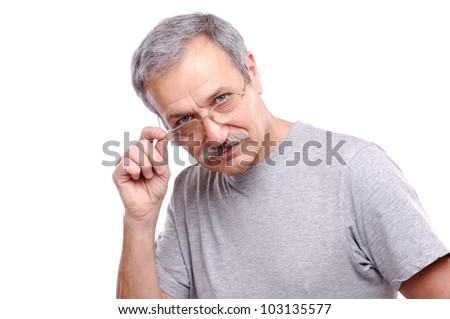 Senior man looking over his glasses - stock photo