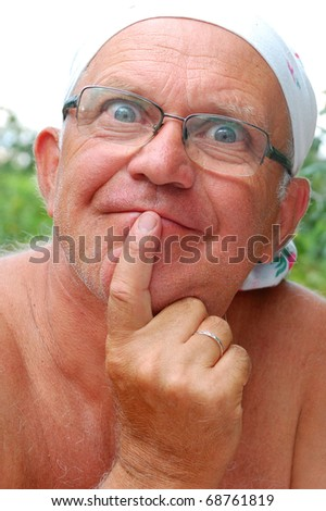 senior man making funny faces outdoor on a hot summer day - stock photo