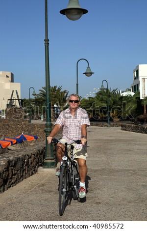 Senior Man On Cycle Ride - stock photo