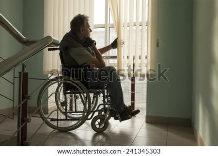 senior man on wheelchair in hospital - stock photo