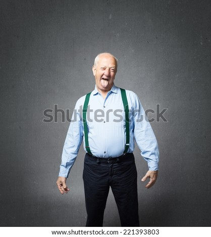 senior man play with tongue - stock photo