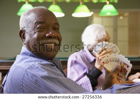 Senior man playing bridge - stock photo
