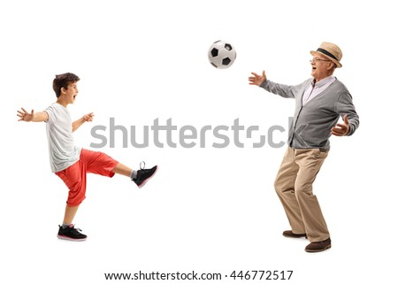 Senior man playing football with his grandson isolated on white background - stock photo