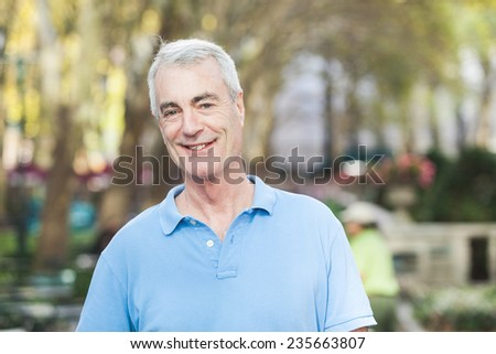 Senior Man Portrait at Park - stock photo