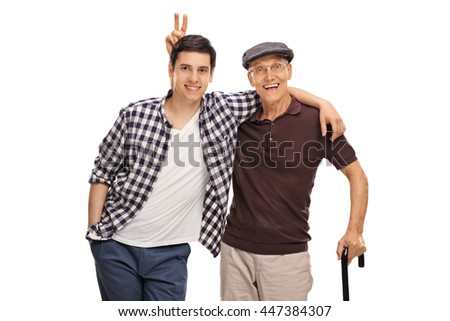 Senior man pranking his grandson with bunny ears isolated on white background - stock photo