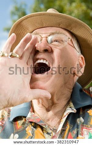 Senior man shouting - stock photo