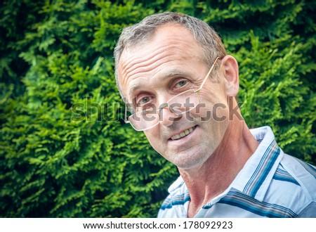 Senior man smiling - stock photo