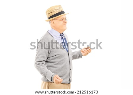 Senior man standing isolated on white background - stock photo