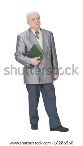 Senior man stands holding a book. - stock photo