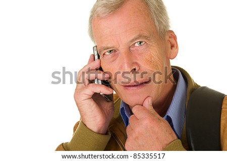 Senior man taking on his smartphone. Smiling. Over a white background - stock photo