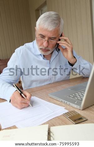 Senior man talking on mobile phone - stock photo