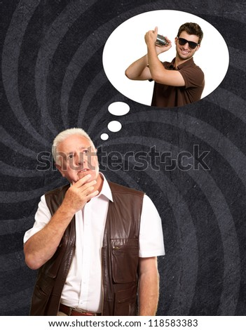 Senior Man Thinking About Man Holding Shaker On Wallpaper - stock photo