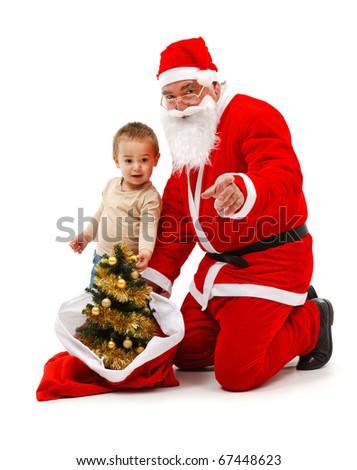 Senior man wearing Santa Claus uniform; bringing attention of a baby boy - stock photo