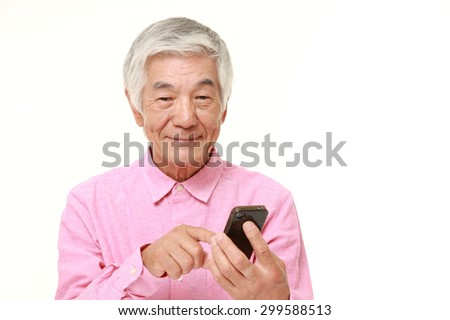 senior man with a smart phone at home - stock photo