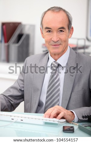 senior man with computer - stock photo