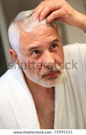 Senior man with hair loss problems - stock photo