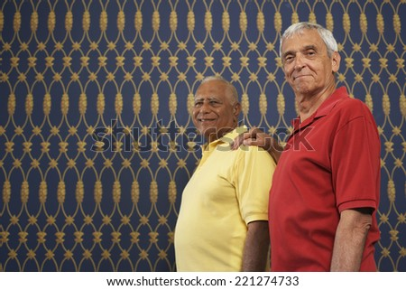 Senior man with hand on friend's shoulder - stock photo