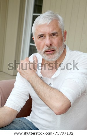 Senior man with osteoarthritis pain - stock photo