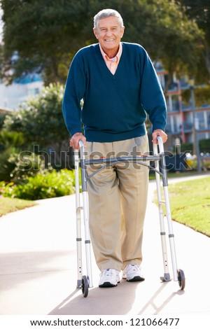 Senior Man With Walking Frame - stock photo