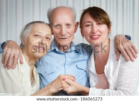 Senior Man, Woman with their Caregiver at Home. Concept of Health Care for Elderly Old People, Disabled. - stock photo