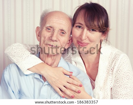 Senior Man, Woman with their Caregiver at Home. Concept of Health Care for Elderly Old People, Disabled. Elderly man, woman. - stock photo