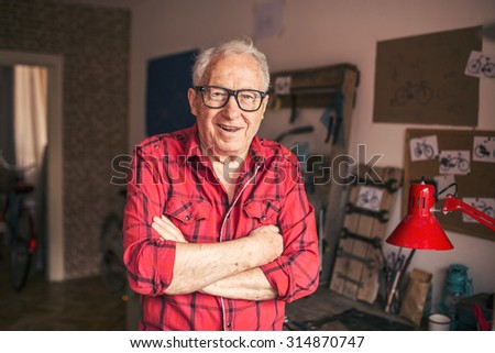 Senior man working in his workshop - stock photo