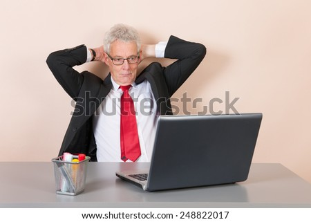 Senior man working with laptop at the office - stock photo