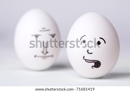 Senior manager egg looking at  unhappy manager egg - stock photo