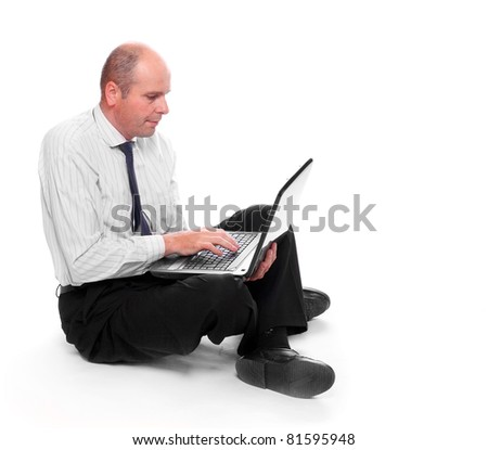 Senior manager looking for a job on a his laptop. - stock photo