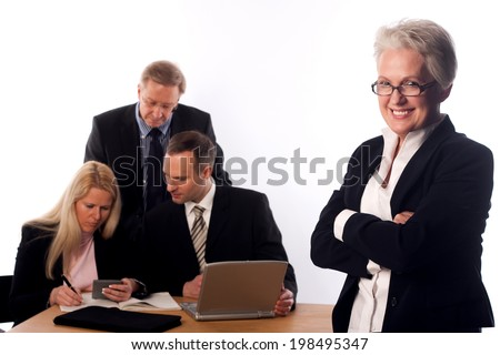 Senior Managerin with her Team - stock photo