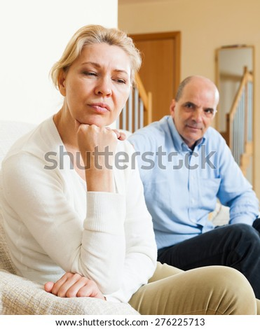 Senior mature wife and husband having quarrel at home - stock photo