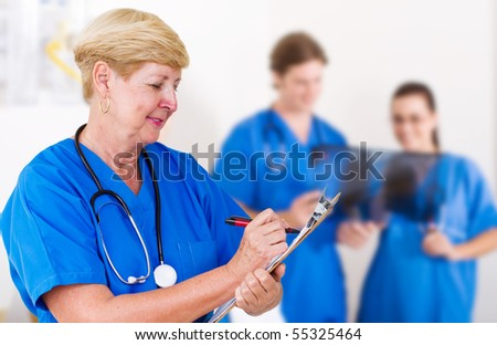 senior medical professional in hospital - stock photo