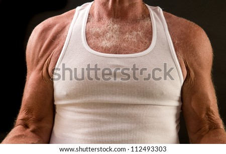 senior muscle: torso, arms, and shoulders of 65-year-old lifting weights - stock photo