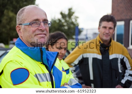 Senior paramedic, wearing a uniform looking into the camera with a confident look in his eyes - stock photo