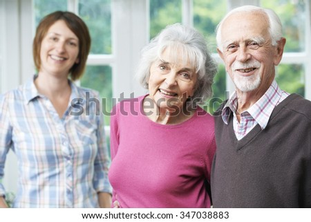 Senior Parents With Adult Daughter At Home - stock photo