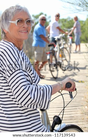 Senior people on bikes - stock photo