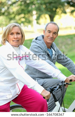 senior people on bikes - stock photo