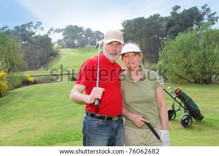 Senior people on golf course - stock photo