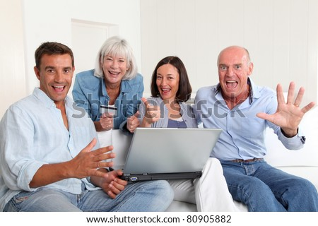 Senior people with couple doing shopping online - stock photo