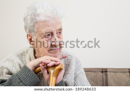 senior person with cane  - stock photo