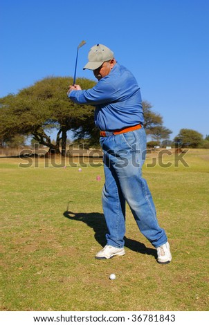 Senior playing golf - stock photo