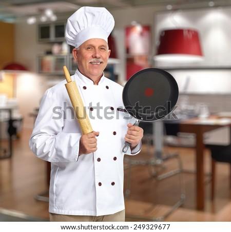 Senior professional chef man in modern kitchen - stock photo