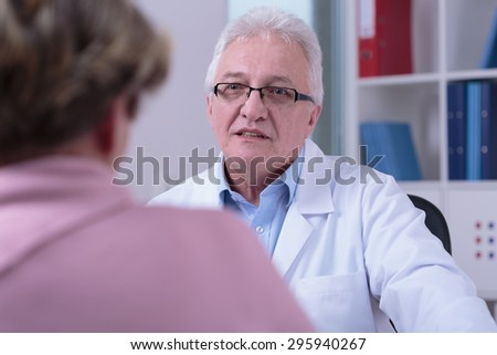 Senior professional male doctor in his office - stock photo