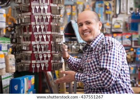 Senior professional with different types of keys in locksmith - stock photo