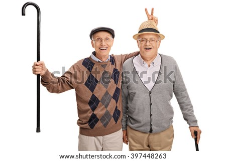 Senior pulling a bunny fingers prank on his friend isolated on white background - stock photo