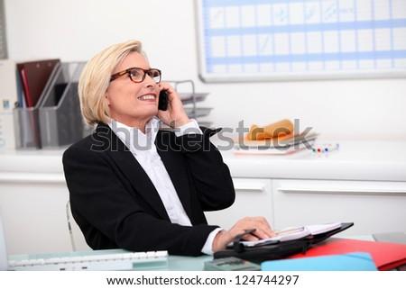 Senior saleswoman hasn't lost her touch - stock photo