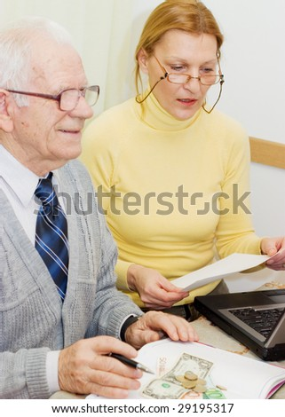 Senior talking to financial planner at home - stock photo